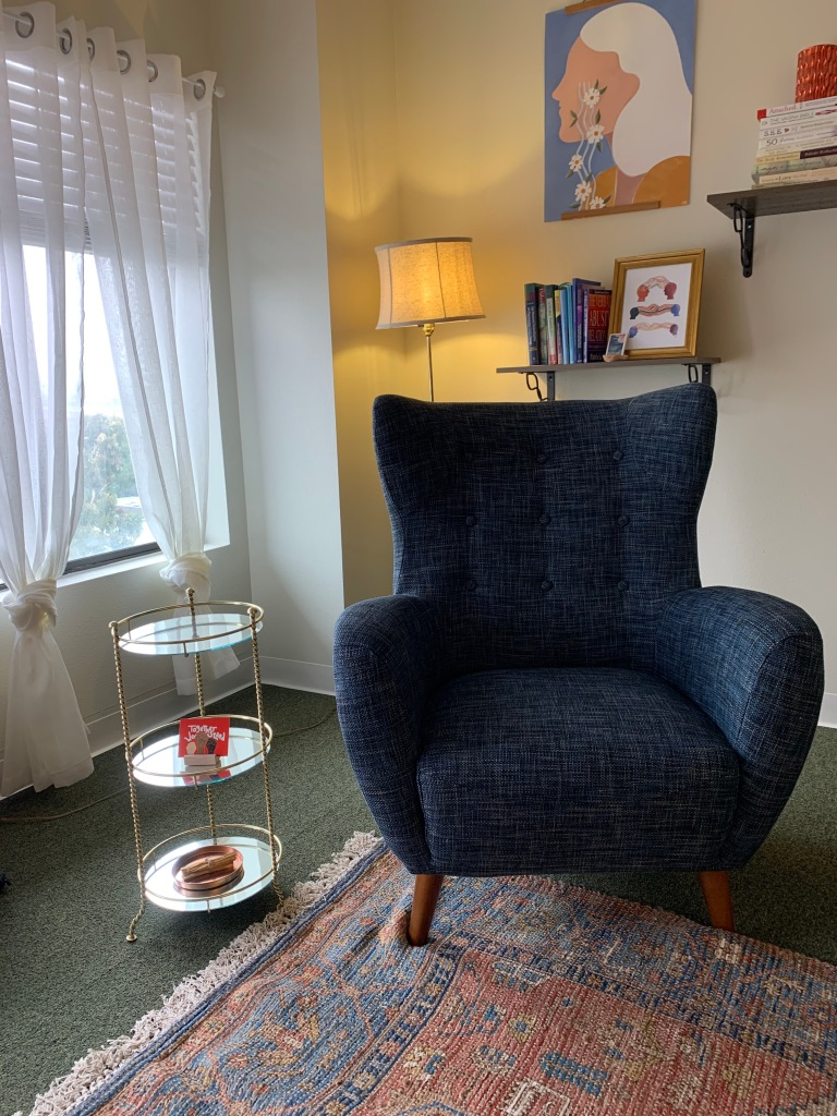 Trauma-informed and comforting picture of a therapy office.